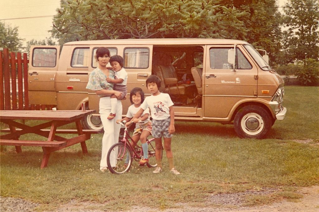 James and his 2 older siblings with their Mom camping in a Ford Scooby Doo van.