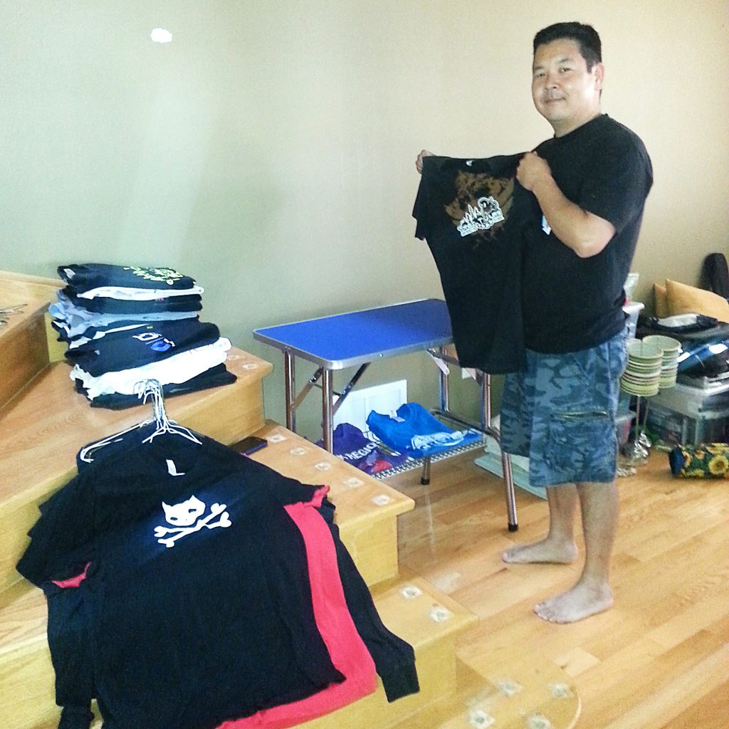 James sorting his T-shirts. He had to purge about 75% of them.