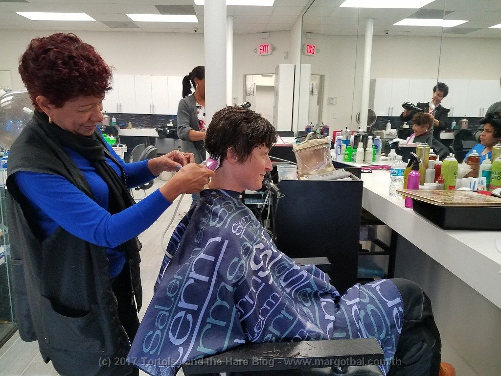 Margot getting her hair cut by a Hispanic woman named Milady in Little Havana
